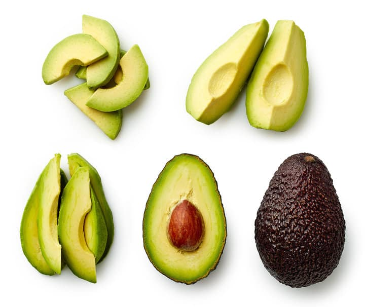 Whole and sliced avocado isolated on white background  Top view