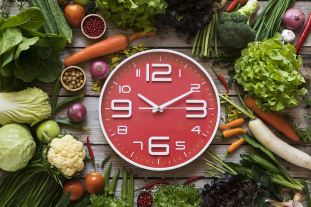 Food clock  Healthy food concept on wooden table