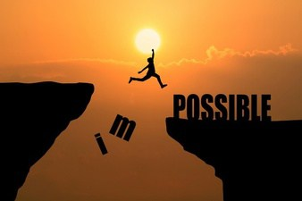 man jumping over impossible or possible over cliff on sunset background business concept idea_1323 266