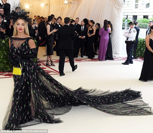 met gala 2018 rita ora exudes sophistication in a semi sheer black gown and a spiked headpiece 5