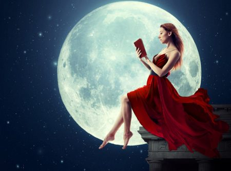 photodune 10290740 woman reading book over full moon xs 450x334