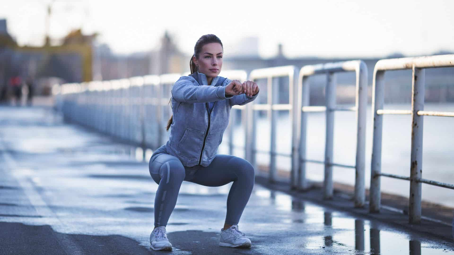 young woman exercising outdoors royalty free image 649970260 1543609738